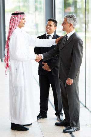 arab people: modern arabian businessman greeting business partners Stock Photo