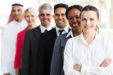 afro arab: group of successful multiracial business team standing in a row Stock Photo