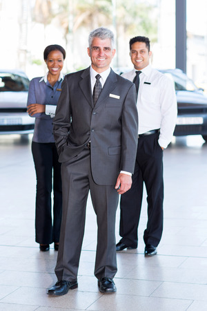 ethnic attire: successful sales staff at a car dealership