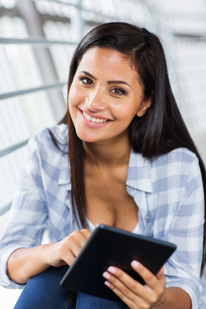 attractive young woman holding tablet computer photo