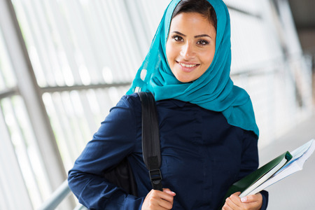 girl studying: modern female muslim college student on campus Stock Photo