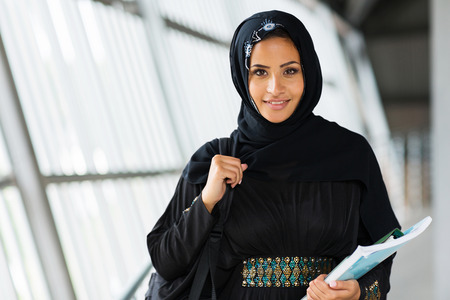 smiling female muslim university student photo