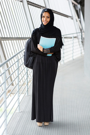 headscarf: portrait of female muslim college student in traditional clothes Stock Photo