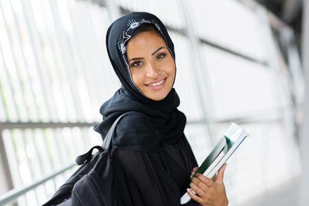 learning arabic: beautiful modern arabian university student with books Stock Photo