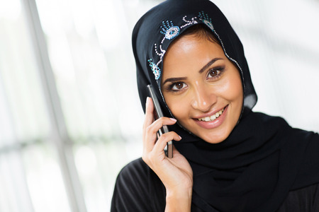 beautiful young arabian woman talking on cell phone photo