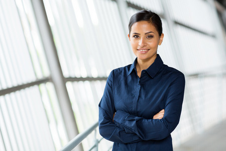 blue collar: beautiful young career woman in modern office