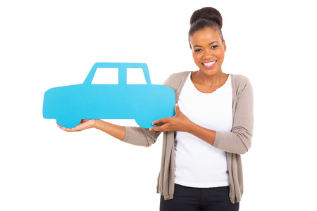 gorgeous african woman holding a car symbol on white background photo