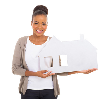 beautiful black woman holding paper house  photo