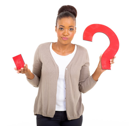 clueless: clueless african woman with paper question mark on white background