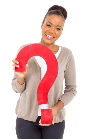 joyful african american girl with question mark on white background photo