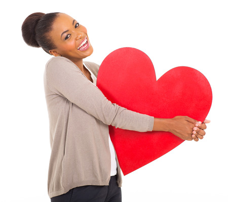 afro american: laughing afro american girl holding paper heart shape on white background
