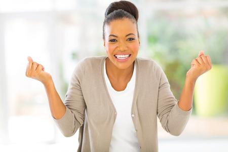 portrait of happy african woman indoors photo
