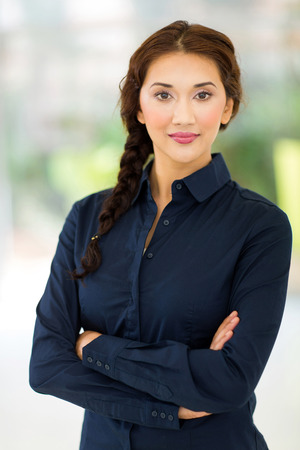 beautiful young businesswoman with arms crossed photo