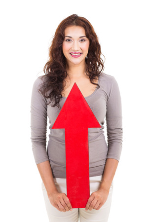 cheerful woman holding an arrow pointing up isolated on white photo