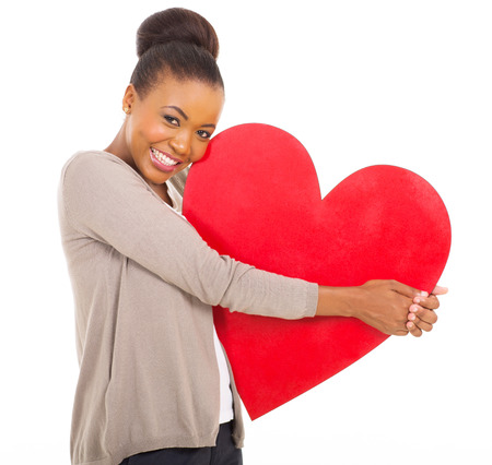 cute african woman holding red heart isolated on white Stock Photo