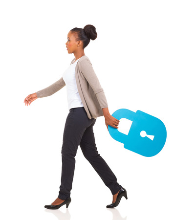side view of african american woman walking with lock symbol on white background Stock Photo