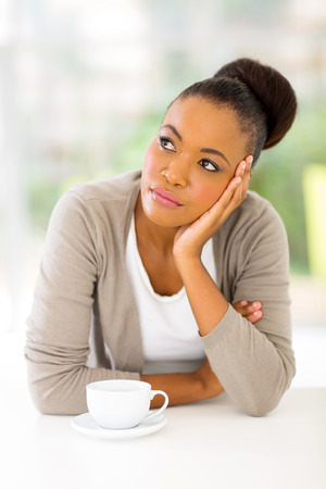 thoughtful africa american woman at home photo