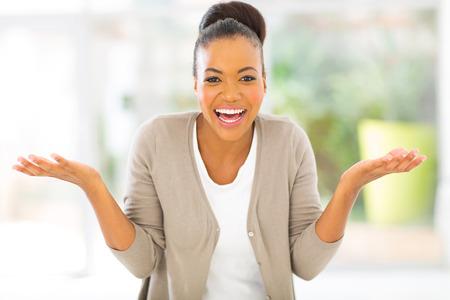 beautiful african american woman looking surprised photo