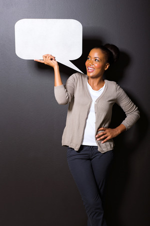bubble people: afro american woman holding speech bubble isolated on black background