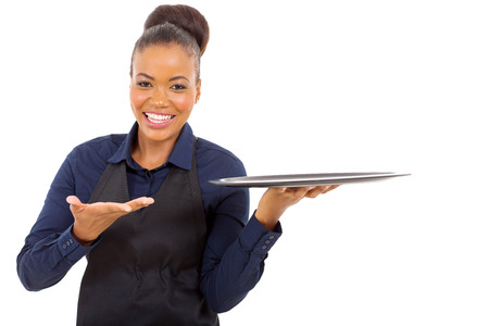 cheerful afro american waitress holding empty tray over white background