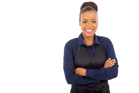 happy african woman: cute african american waitress with arms crossed isolated on white background