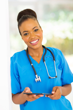 beautiful african american medical worker with tablet computer photo