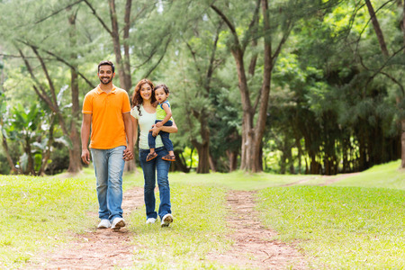 indian happy family: happy young indian family going for a walk in forest Stock Photo