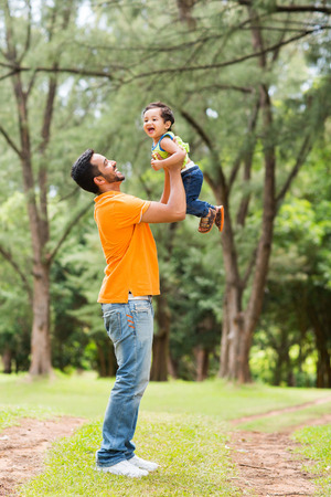 indian happy family: happy young father playing with son outdoors Stock Photo