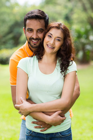 portrait of happy young indian couple enjoying summer day outdoors Stock Photo