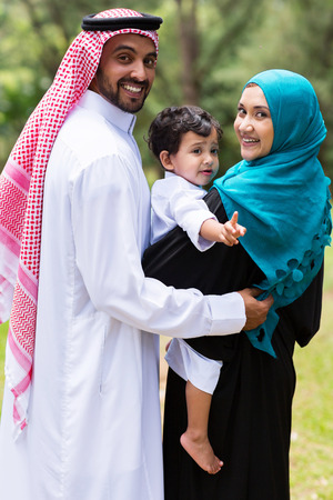 muslim baby girl: happy islam family looking back