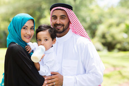 portrait of traditional muslim family outdoors photo