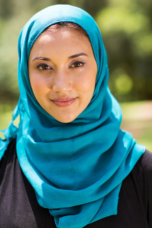 arab people: attractive Muslim woman closeup portrait outdoors