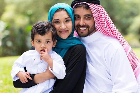 beautiful middle eastern family outdoors photo