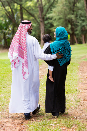 muslim baby girl: lovely middle eastern family walking at the park