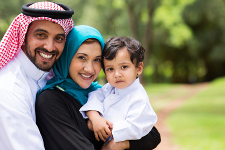 portrait of Arabic family at the park photo