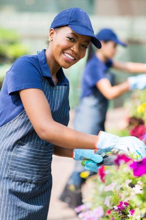 farm worker: beautiful african american female florist working in nursery