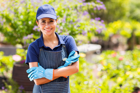 pretty female garden center worker portrait photo