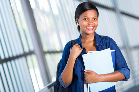 african education: happy young african college girl looking at the camera Stock Photo