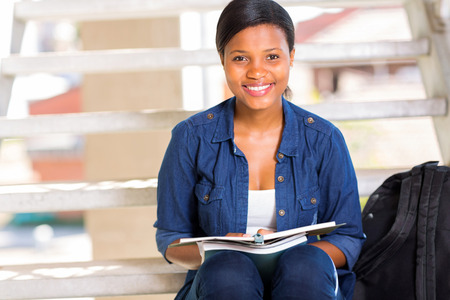 gorgeous female african college student sitting on steps photo