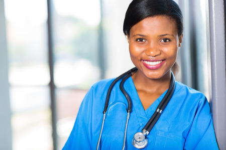 black nurse: attractive female african american medical professional in office