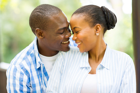 portrait of young african american couple looking at each other outdoors photo
