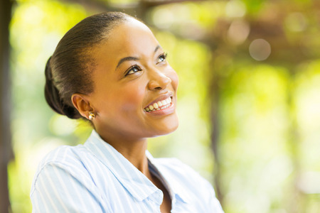 lifestyle outdoors: cute young african woman daydreaming Stock Photo