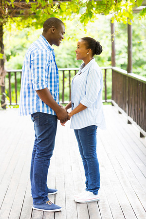 couple holding hands: lovely african american couple holding hands outdoors Stock Photo
