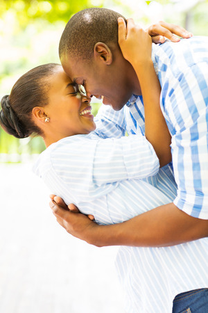 ethnic couple: intimate young african couple flirting