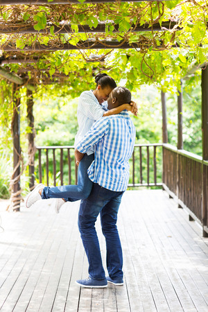 carefree young african american couple playing outdoors photo