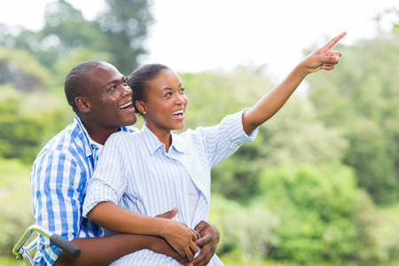 carefree african couple in the forest bird watching photo