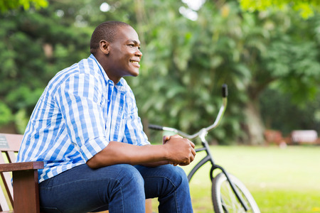 handsome young african man sitting outdoors