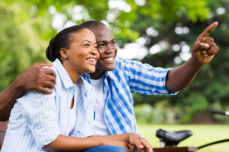 lovers park: cheerful afro american couple relaxing outdoors
