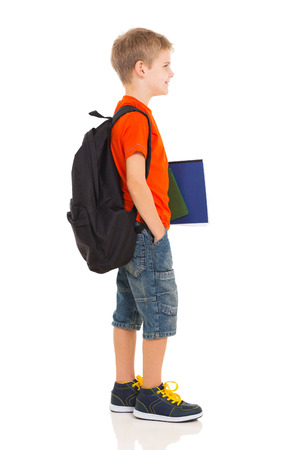 happy young people: happy schoolboy going to school isolated on white