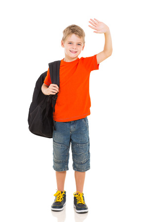 schoolboys: smiling schoolboy with backpack waving goodbye